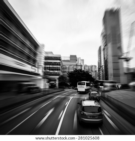 Traffic moving at speed on the road, Black and White - stock photo