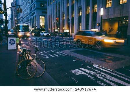 Traffic moving on a street in the Financial District, Manhattan, New York. - stock photo
