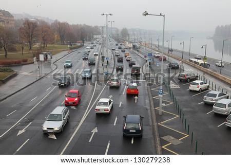 Traffic of cars on an urban road - stock photo