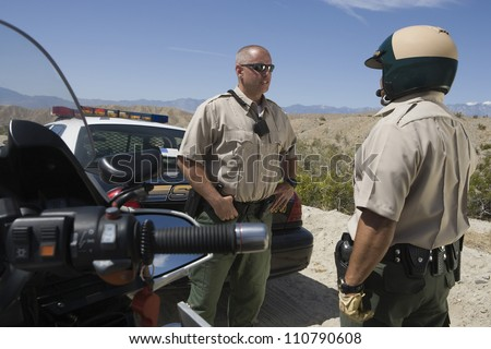 Traffic officers having conversation - stock photo