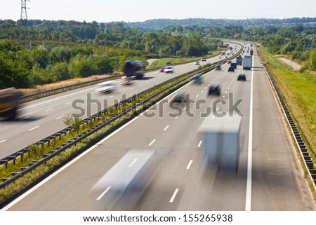 traffic on a highway - stock photo