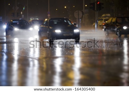 traffic on a rainy night - stock photo