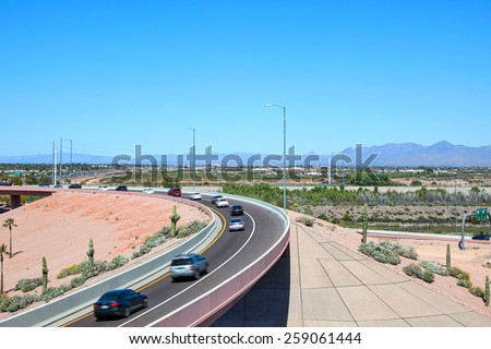 Traffic on a the 101 & 202 interchange over the Salt River near Phoenix, Arizona - stock photo