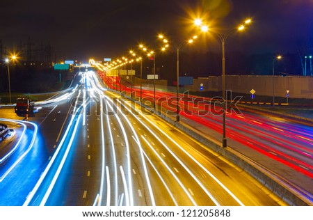 traffic on highway at night on background of Moscow