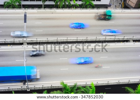 Traffic on overpass in Singapore. Motion blur