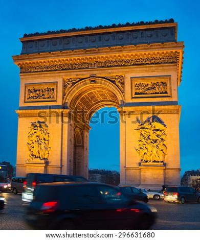 Traffic on Paris road in front of Triumph Arch. Paris - stock photo