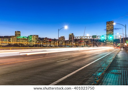 traffic on road with cityscape and skyline of portland at twilight - stock photo
