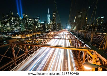 Traffic on the Brooklyn Bridge at night, in Brooklyn, New York. - stock photo