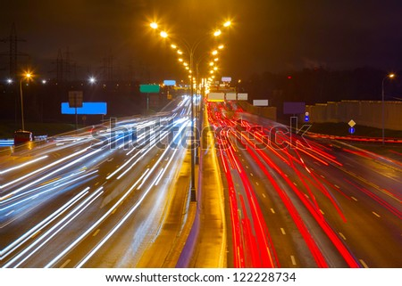 traffic on the highway at night on the background of Moscow - stock photo