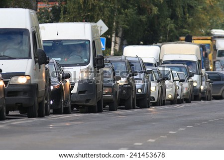 traffic on the road in a European city, stopping vehicular traffic, stop cars - stock photo