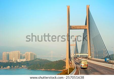 Traffic on Tsing Ma bridge at sunset. Hong Kong - stock photo