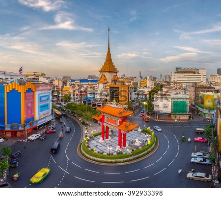 Traffic passes through Chinatown at Odeon Roundabout. The roundabout marks one end of Chinatown, Bangkok, Thailand - stock photo