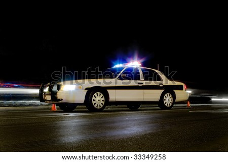 Traffic police car with lights on & motion blur behind it - stock photo