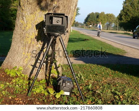Traffic police mobile radar with photo camera - stock photo