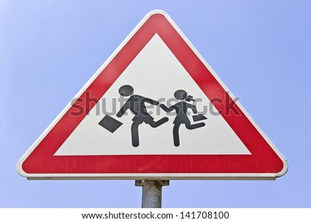 Traffic road school sign over blue sky - stock photo