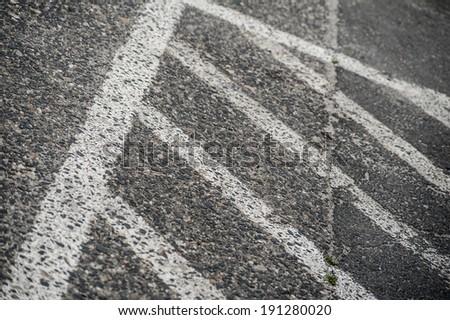 Traffic road white painting prohibited area sign on grey asphalt - stock photo