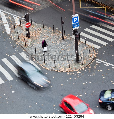 traffic scene with cars in motion blur seen from aerial perspective - stock photo