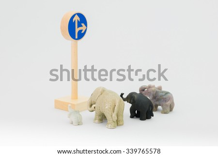 Traffic sign and elephants - stock photo
