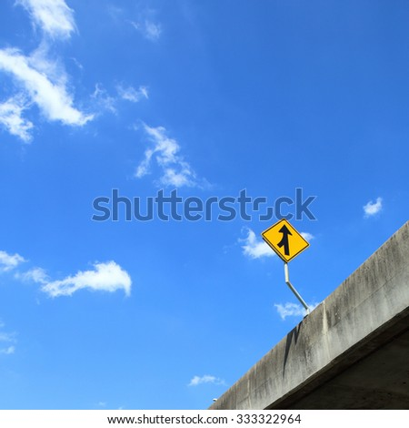 Traffic sign Beware junction under cloudy blue sky. - stock photo