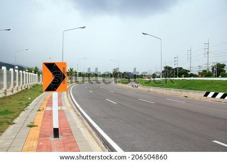 traffic sign curve sidewalk - stock photo