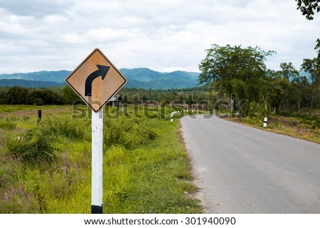 Traffic sign curveon country road - stock photo
