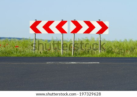 traffic sign direction of movement to the right or left - stock photo
