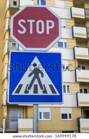 Traffic sign for pedestrian crossing and stop sign in a residential area - stock photo