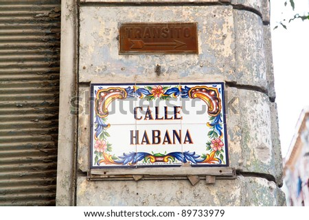 Traffic sign for tansit street and sign of name of street against old wall, Havana , Cuba