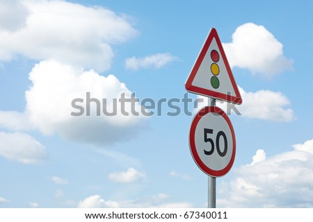 Traffic sign in the dark blue sky with white clouds