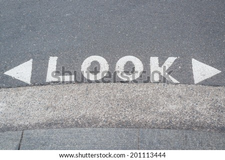 """Traffic Sign """"look"""" at the road - stock photo"""