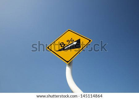 Traffic sign of the uphill slope - stock photo