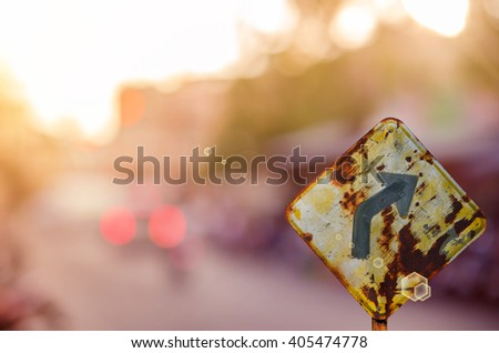 Traffic sign,old curve road sign on blur traffic road abstract background.Retro color style. - stock photo