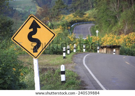 Traffic sign on mountain route - stock photo