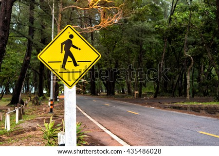 Traffic sign pedestrian crossing near beach.. - stock photo