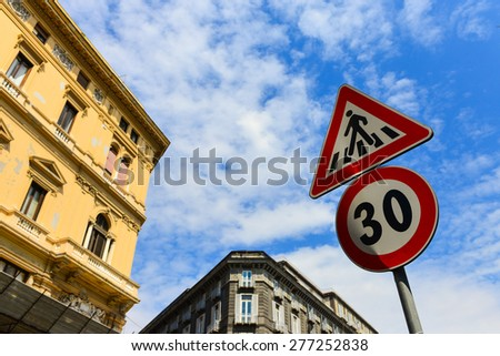 traffic sign pedestrian crossing , Thirty mile per hour street sign with dramatic clouds in background - stock photo