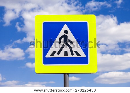 Traffic sign pedestrian crossing with clouds in background - stock photo