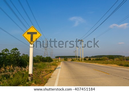 traffic sign post in rural road under blue sky