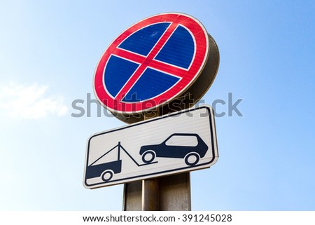 Traffic sign prohibiting parking. Evacuation on tow truck - stock photo