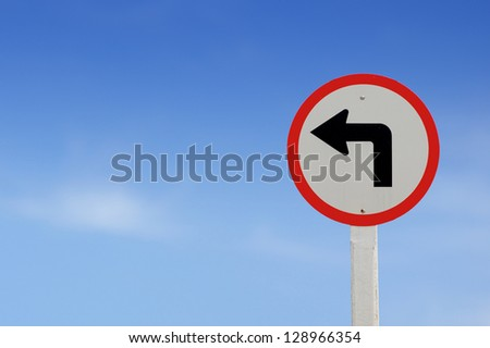 Traffic sign show the turn left on blue sky blank for text - stock photo