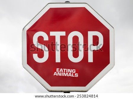 Traffic sign stop with the words: eating animals
