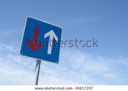 traffic sign with red and white arrow, oncoming traffic
