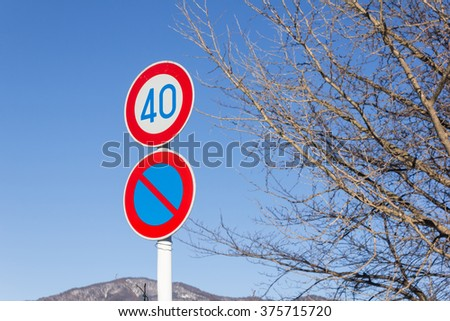 traffic sign with speed limit  in winter - stock photo