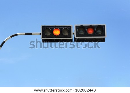 Traffic signal and blue sky