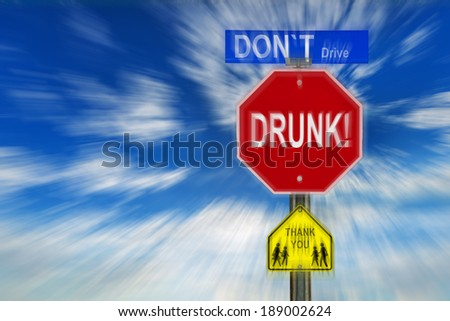 Traffic signs against a cloudy blue sky with the words Don't Drive Drunk, Thank You written on them.  Image is blurred to imply motion and blurred vision due to intoxication.     - stock photo