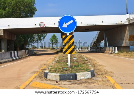 Traffic signs and road - stock photo