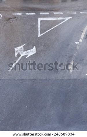 traffic signs on asphalt - stock photo