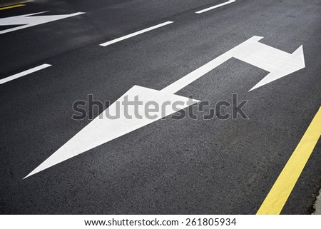 Traffic signs painted on the road. - stock photo