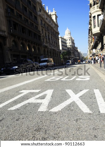 Traffic signs Taxi and Bus , low angle view of street with painted sign demarcating lanes