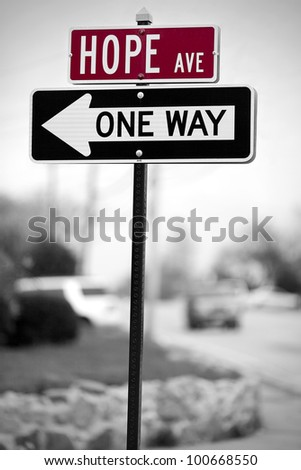 Traffic signs with Hope avenue and One Way direction written on them. - stock photo
