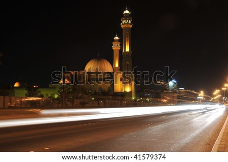 Traffic streaks by the Grand Mosque in Manama, Bahrain